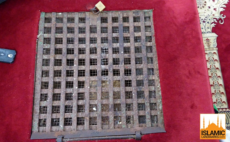 Grille in the basement floor showing floor below