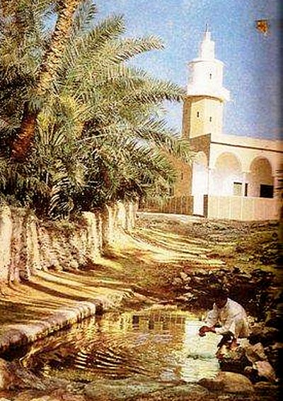 Historic photo of Masjid Areesh with spring in front